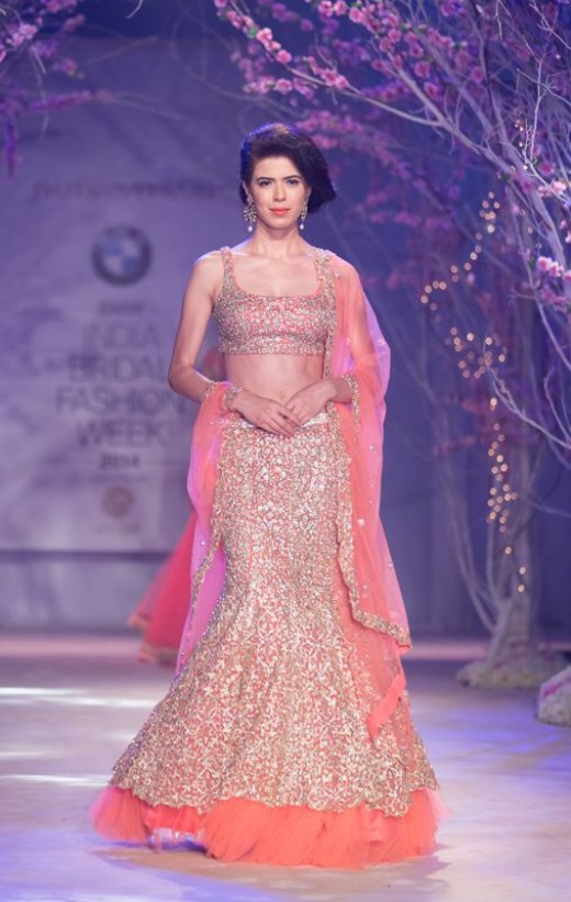 Lovely embellished peach-color mermaid-cut bridal lehenga