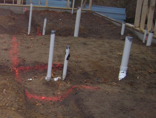 Underslab plumbing has to be installed early, before the slab is poured