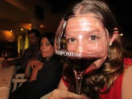 Gaze at people in the restaurant through your wine gass and do not bat an eye