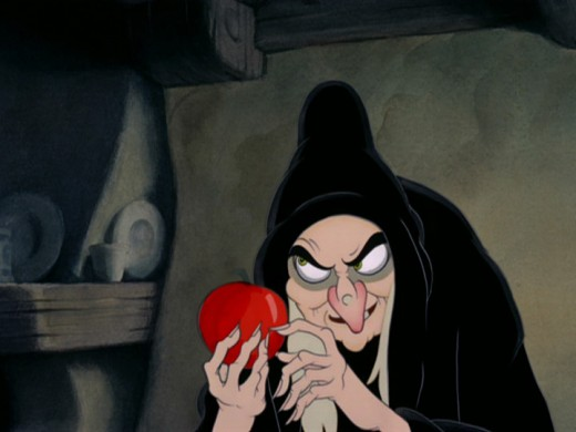 Old hag presents poison apple in Disney's Snow White and the Seven Dwarfs