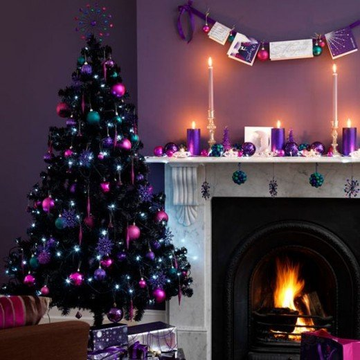 Black Christmas tree decorated with rich purple ornaments