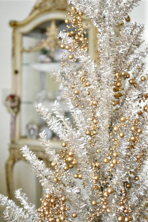 Glam Christmas tree decorated in glittery, rose gold colors.