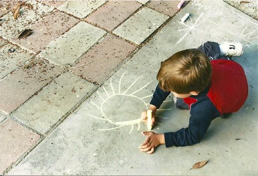 My grandson decorating my patio