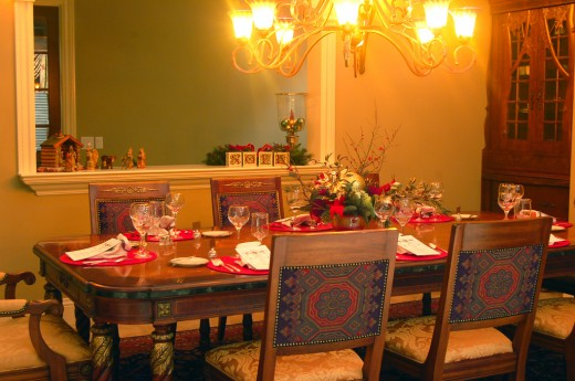 A Christmas dinner table arrangement and setting