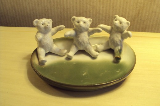 3 bears on a pin dish. I could not establish a value on this one. Rare