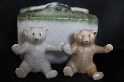 2 bears, one white, one brown in front of a basket. $18. Rare.