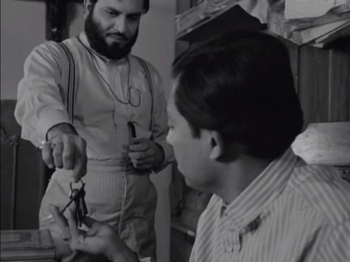 Bhupati gives the keys in Charulata