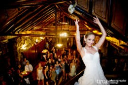 Bride throwing her bouquet is one of the highlights of any wedding