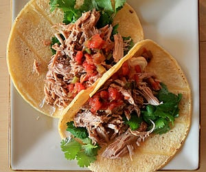 In Mexico these wonderful tacos are made with shredded cooked pork roast.