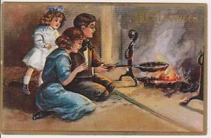 A group of children roasting nuts over a fire to foretell their futures on All Hallows Eve.