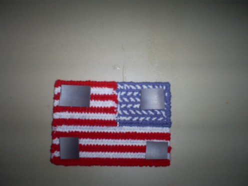 Add the magnets to the backside of the cross stitched flag.