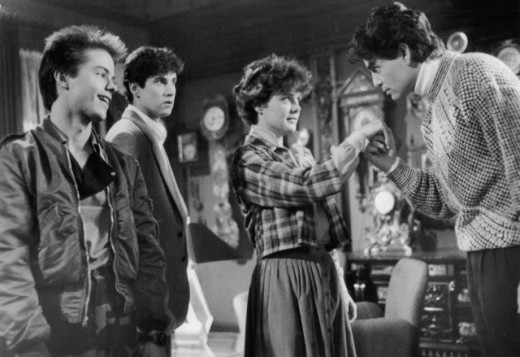Chris Sarandon charms Amanda Bearse in Fright Night as Stephen Geoffreys and William Ragsdale look on