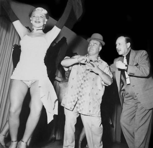 (from left), Beautiful Vegas showgirl being admird by Lou Costello, and Bud Abbott, famous Hollywood comedians