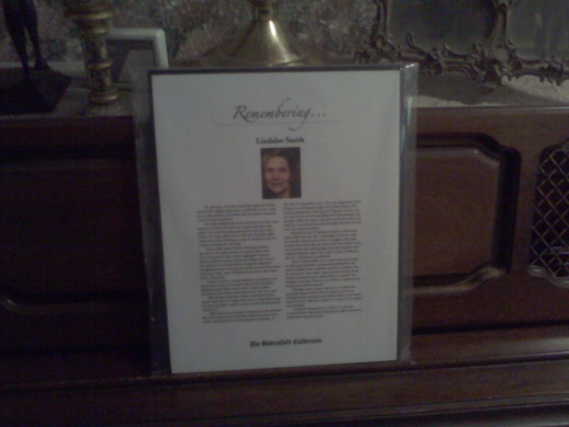 Mom's Obituary plaque sits on her piano
