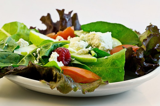 A healthy salad combines greens, vegetables, protein and a little dressing.