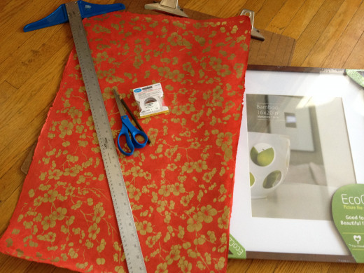Supplies you will need: Art paper, T-square, sharp paper scissors, pencil, mounting tape, picture frame with glass, protective surface on which to score and cut the paper