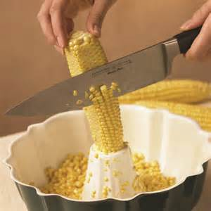 Hold ear over bundt pan and cut away kernels