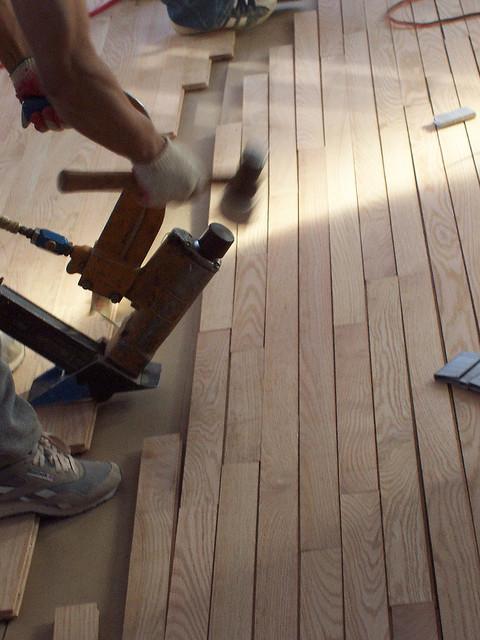 Installing flooring with pneumatic nail gun