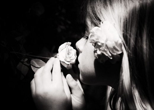 Girl smelling a rose