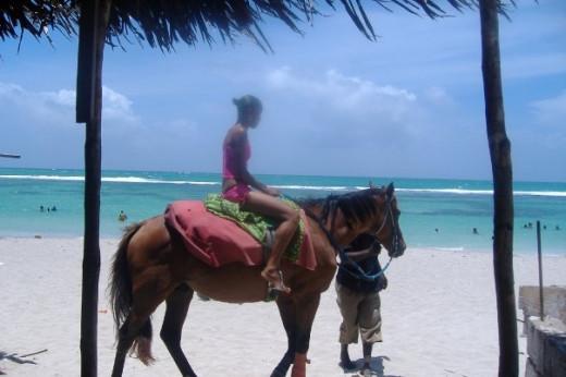 Horseback riding on the Hellshire beach in St. Catherine, Jamaica
