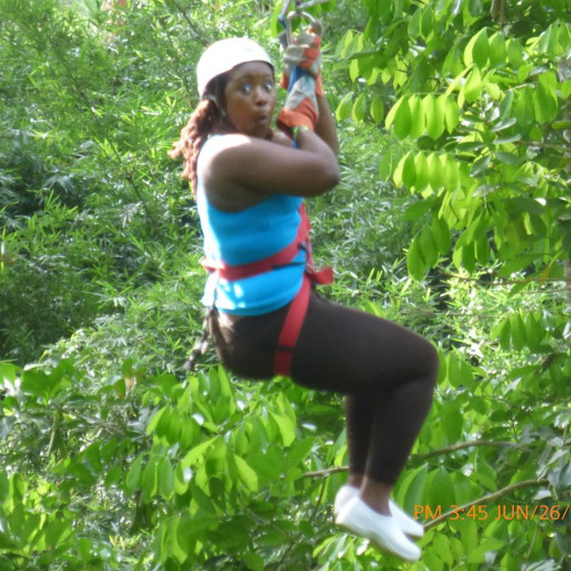 My younger sister at Chukka Caribbean Adventure Tours, on the zipline