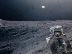 This now infamous photograph clearly shows a UFO above a NASA astronaut as he walks on the Moon.