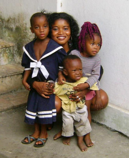 Janet, Blessing on her left, and kids from around the compound