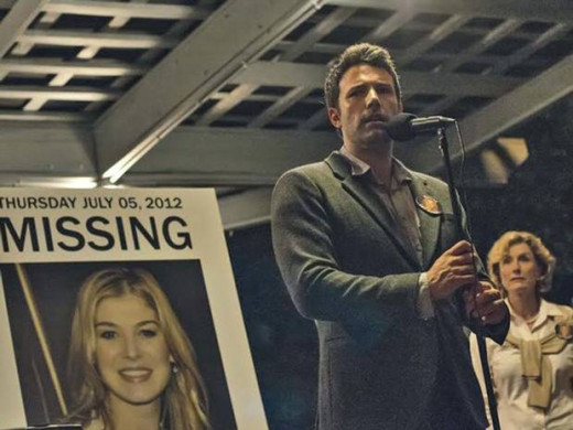 "Nick (Ben Affleck) is either playing a part or actually grieving at a vigil for his missing wife in ""Gone Girl""."