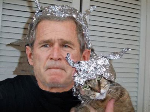 Neither George Bush Nor Even His Cat Have Tin Foil Hats As Large as Mine.