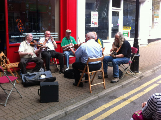 Joining in a session of buskers playing Irish traditional music.