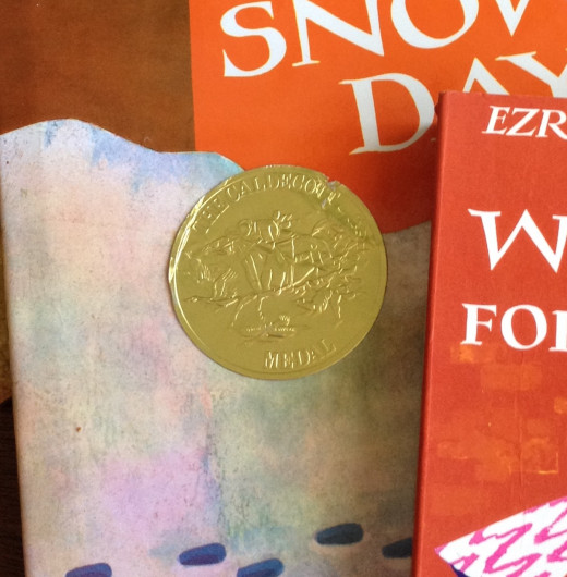 Even though this is a newer copy of the book, the Caldecott Medal Award sticker is a little worn where the baby tried to peel it off