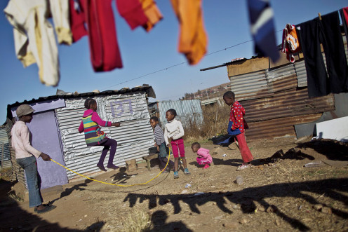 Children in Africa playing outside their homes.