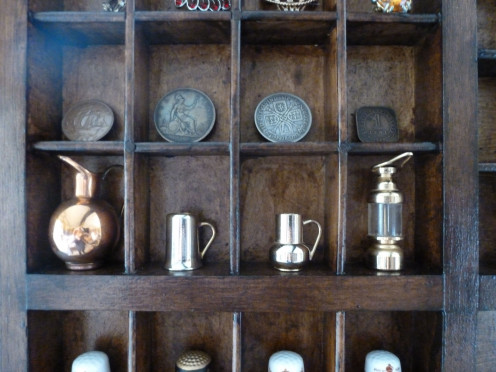 Small brass items including a miners lamp