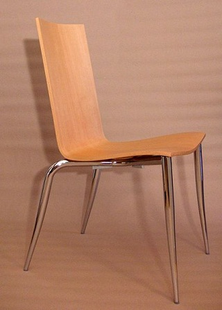 This chair, design name 'Tango' by Philippe Starck, is simple and elegant and a complete contrast to the furniture shown below.