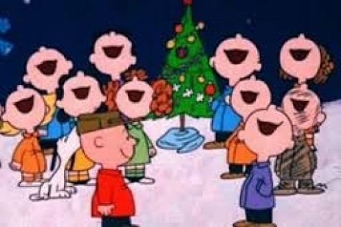 Spread Holiday cheer by singing Christmas carols with family and friends just like Charlie Brown and the Peanuts gang are doing in this photo.