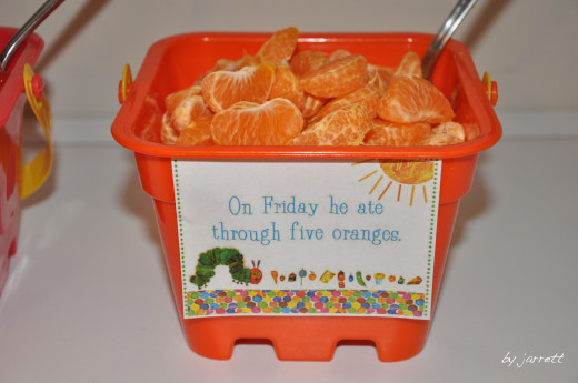 The different days of fruit served in colorful buckets