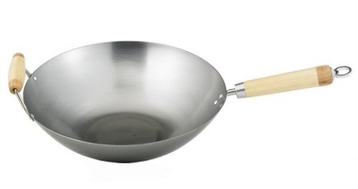 The Helen Chan is an excellent wok for beginners.  This traditional carbon steel wok is available in 12 and 14 inch sizes.  Note that this style of pan has one long handle and one loop handle.  Others sometimes have two loop handles.