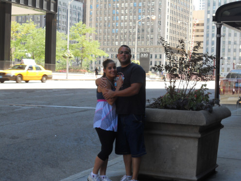 My husband and I taking a photo downtown Chicago