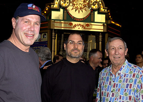 Steve Jobs (center) doesn't look at all happy with Michael Eisner, (left), former head of The Walt Disney Company, and Roy Disney, Walt's nephew and son of Walt's brother Roy, the co-founder of The Walt Disney Company.