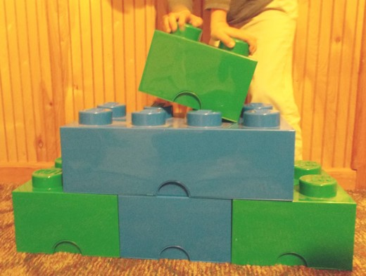 Lego storage boxes can be used for building structures, too.