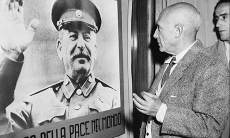 Picasso inspects a picture of Stalin in 1949. Photograph: AFP/Getty Images -/AFP/Getty Images