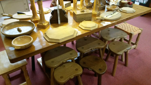A Dining Room Table and Chairs Carved in Oak by the Mouseman. £15,000
