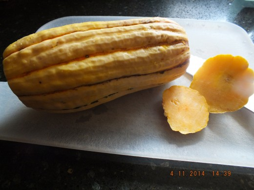 This is a Delicata squash. It's sweet and creamy. Start by cutting the ends off to create a more stable surface to slice.