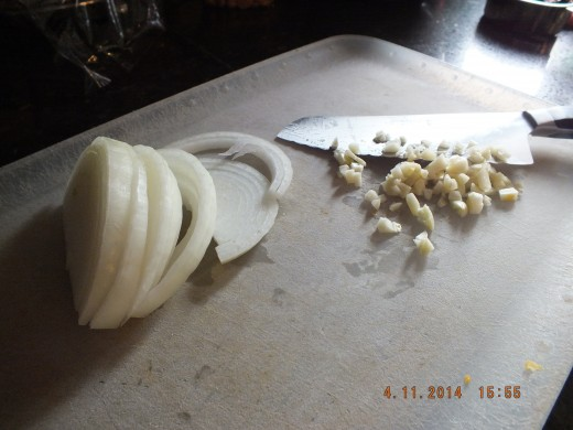 Thinly slice your onions and mince your garlic.