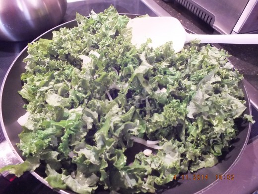 Now it;s time to add about 2 teaspoons of oil to the already hot pan-- so be careful. Add the kale and close the lid for about 2-3 minutes.