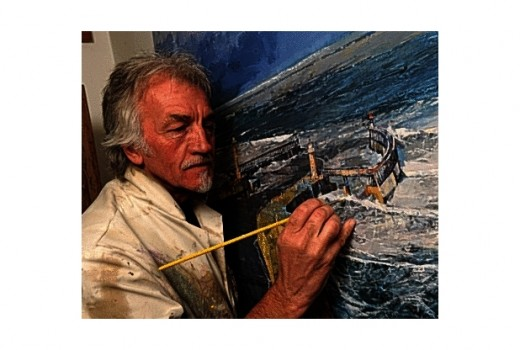 Tom Harland in his studio finishing a painting of Whitby Harbour
