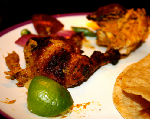Lapping up a portion of Tandoori Cornish Hen with hot Phulkas/Chapatis.