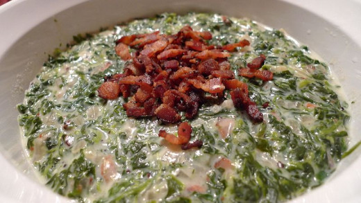 A creamed spinach topped with bacon.