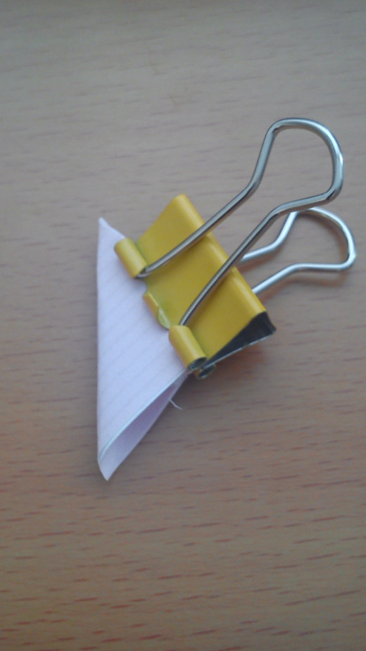 Hold in place with a bulldog clip or paper clip until glue has dried.