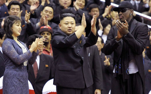Kim Jong Un, the Korean leader with Dennis Rodman an American basketball player.